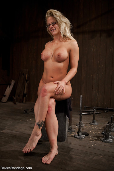 Thick blonde playgirl Holly Heart having bare feet caned in bondage