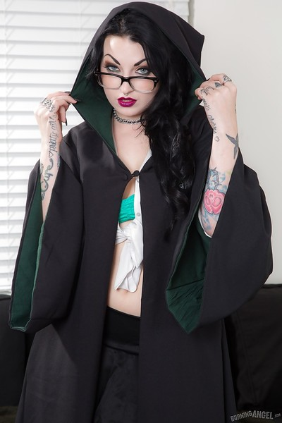 Tattooed goth chick strutting solo in pleated skirt and over the knee socks