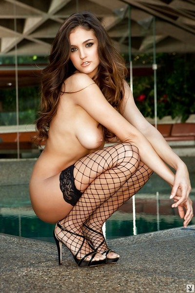 Appealing brunette babe Jaclyn Swedberg posing in fishnet stockings