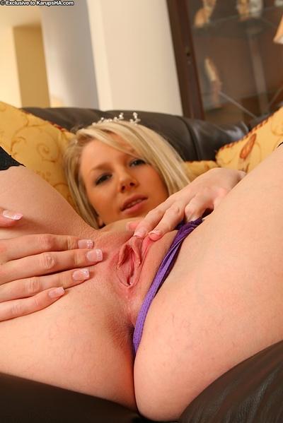 Masturbating babe Danielle Maye is having her ass shown in ebon nylons