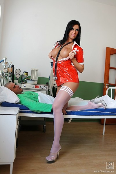 European slut Cloe is doing some posing in her red nurse uniform