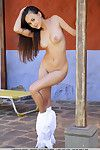 Eastern babe Li Moon displaying shaved teen pussy during glamour photo shoot