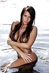 Beautiful babe with tanned skin Madison Ivy is posing on the beach