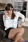 Cute babe in glasses Holly Michaels shows her peachy body in office