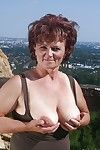 Naughty granny uncovering her fatty body with bendy bumpers outdoor