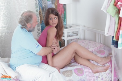 Appealing youthful Alyona lays on her bed, and looks clammy in her pink outfit. This girl reads her phone but wakes with a headache. Her grandpa arrives to help out