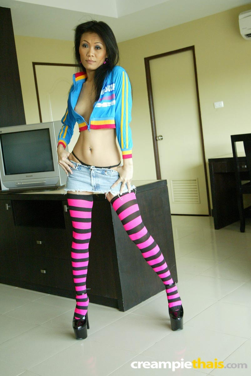 Pla removes clothes her pink and black striped stockings