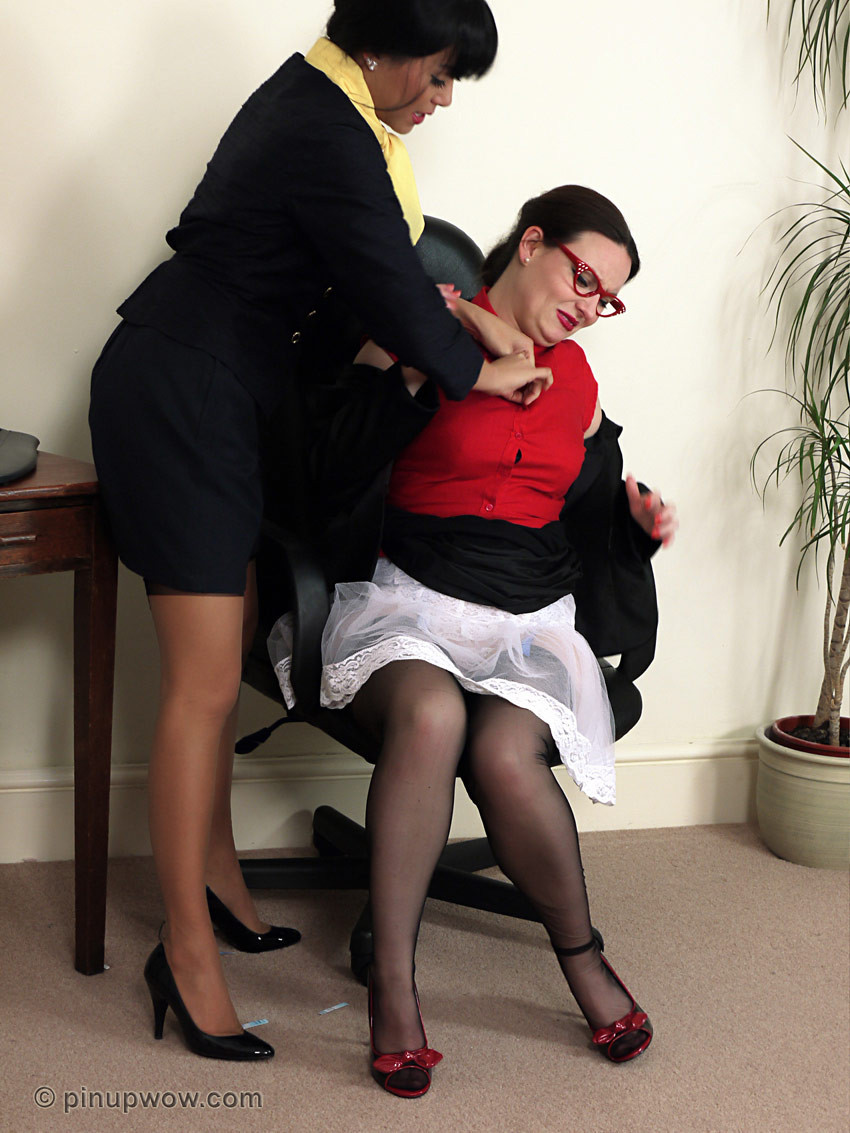 Two bawdy office pretties slide out in the office