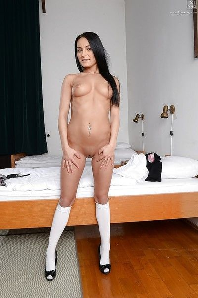 Cute night-time schoolgirl Lexi Dona posing in skirt and white socks