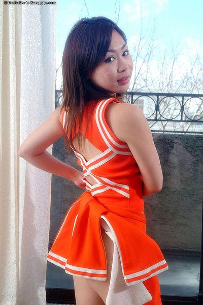 Brunette Asian bush-leaguer girl Yumi teases her teen pussy in arrange up