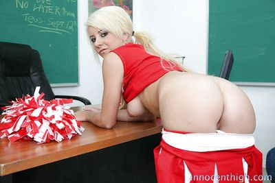 Blonde teen Tessa Taylor shows big tits in cheerleader unvarying