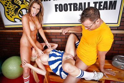 Lascivious cheerleader sharing a thick cock with her horny coach
