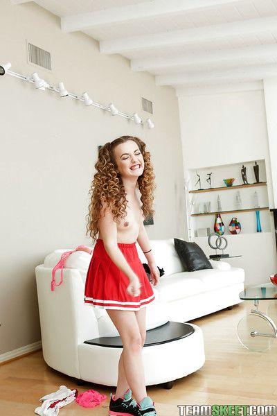 Barely legal teenager Marissa Mae posing in cute cheerleader uniform