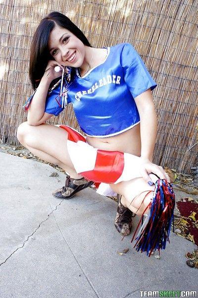 Brunette cheerleader Savannah Camden teases her teen as outdoors