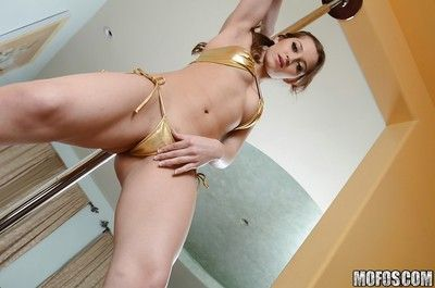 Teen cheerleader Dani Daniels pulls up her skirt to kickshaw her gloryhole