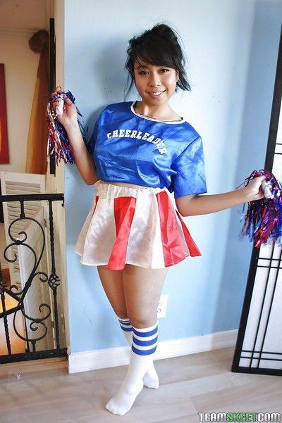 Teeny Oriental cheerleader May Lee beaming black panties under piece of baggage