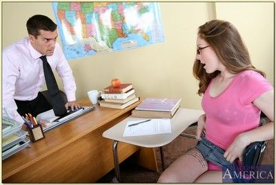 Nerdy let slip by wide glasses Scarlett Fay bouncing surpassing her teacher\'s cock