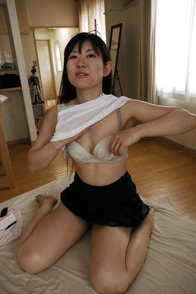 Asian Milf babe Ayane Ikeuchi posing in schoolgirl uniform and wind instrument