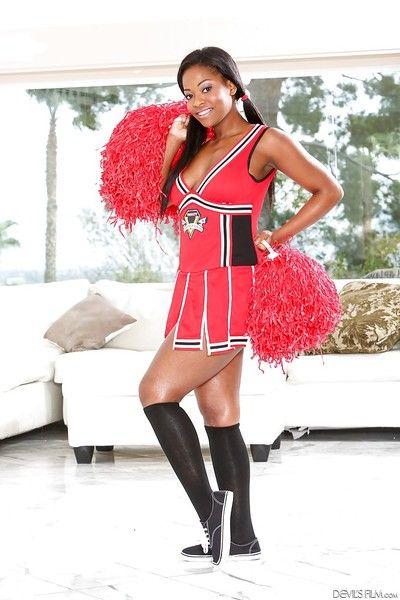 Slutry Ebony cheerleader with big tits spreads their way pussy lips.