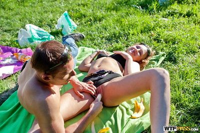 Sweet coeds get their fannies glazed with cum after a threesome alfresco