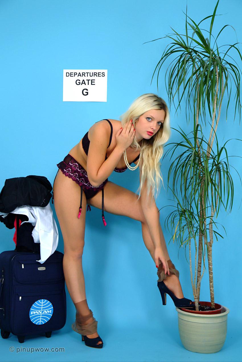 Untamed blond air hostess exposes her untamed underware