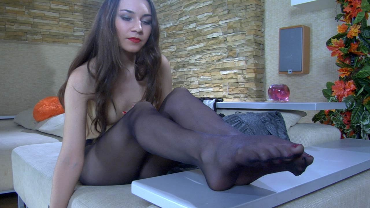 Angelic covert haired gal exposing her covert legs in ebony hose