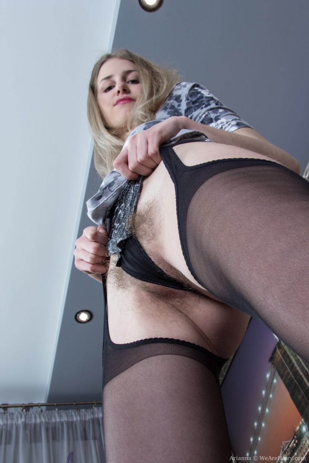 Arianna disrobes uncovered from suit and