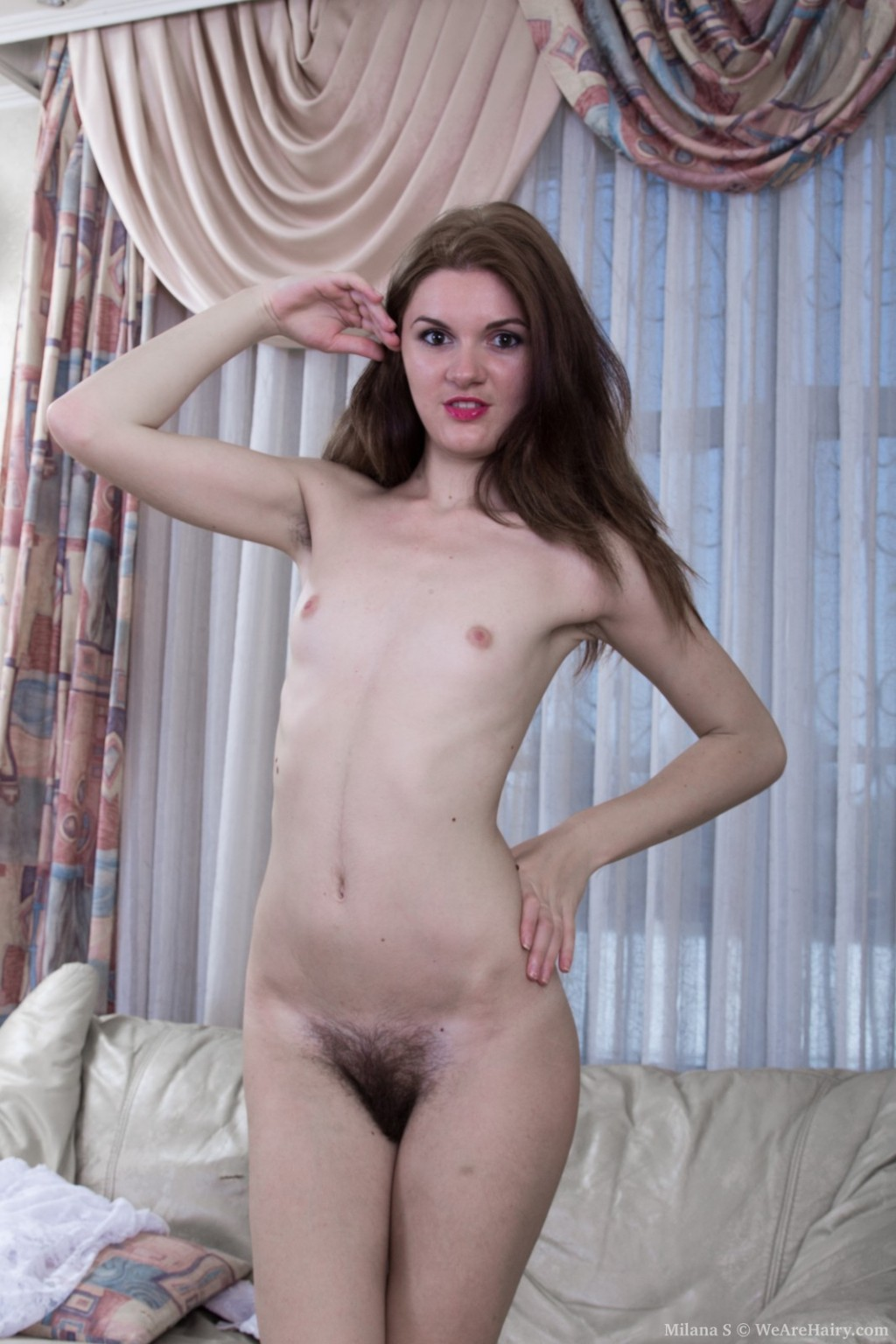Milana s indolently removes clothes and shows off untamed body