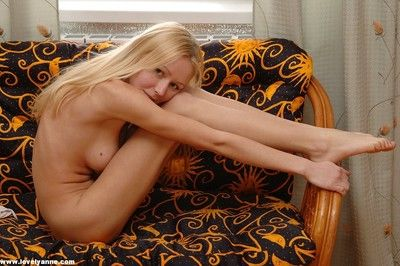 Teen girl takes her pants off posing naked