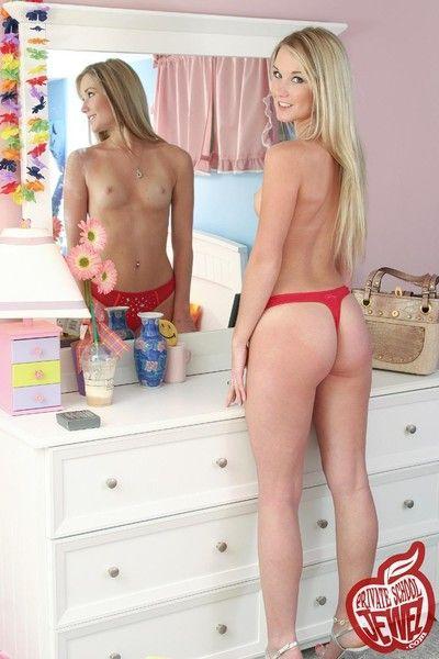 Cute blonde teen dame around bedroom