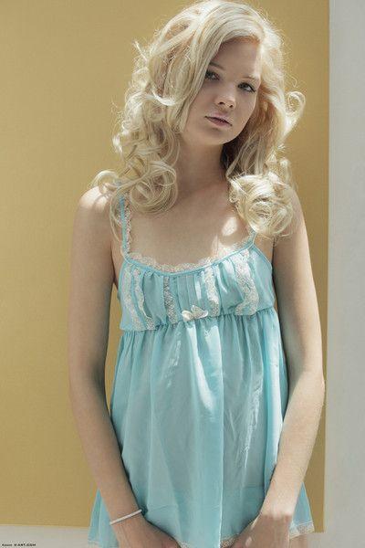 Beautiful blonde teen in nightie