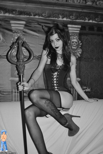 Sexy young halloween evil spirit girl in stockings