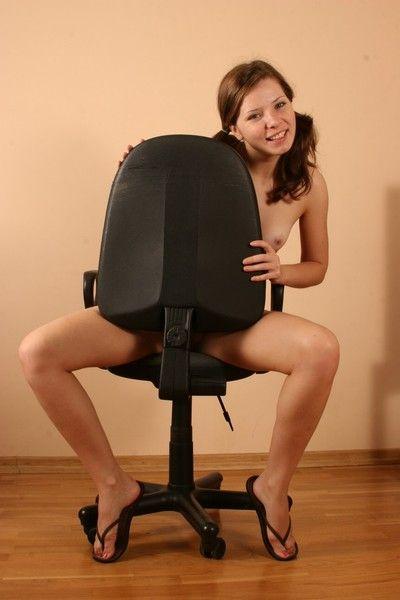 Kimmy making strip-show exceeding a chair