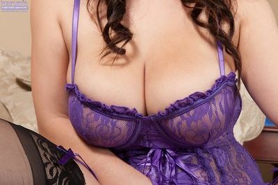 Beauty Noelle Easton takes off her purple undergarments so sensual