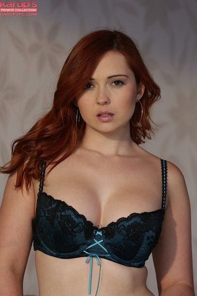 Redhead model Anjell Summers demonstrates her stunning boobies