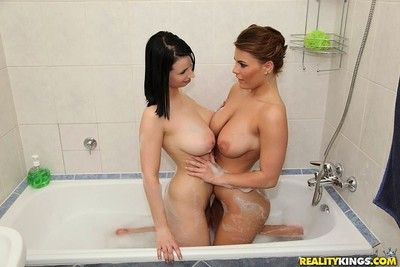 Two hungarian girls are interesting a bath before wild orgy