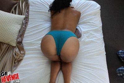 Sexy go steady with exposing her ass covered with panties increased by posing nigh bikini