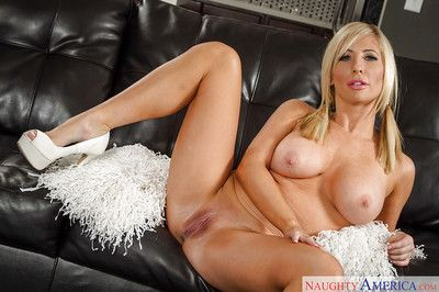 Blonde cheerleader Tasha Reign undresses to parade her big boobies