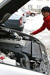 Its a cold winter day, and Kim is having compressing getting her car to start. Luckily an older repairman is with and able to help out.