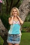 Adorable blonde strips with an increment of fingers outdoors