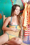Get under one\'s young teen convocation of emily 18 looks pulchritudinous in the yellow bikini. we espy her na