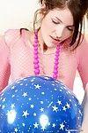 Skinny teen near balloons