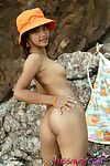 Shy tussinee shows her perfect naked body outdoors