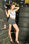 Emily 18 stands among the tires in the shop and the cute young young gentleman does a gang