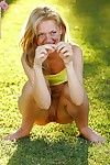 Smiling teen showers morning grass with pee