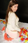 Emily 18 wears a sweater, white-hot fishnet pantyhose, and skintight boyshort panties