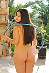 Nadine hula hoops naked outside