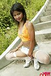 Hot babe tussinee in all directions epitomize off jean shorts and fishnets showing off outside