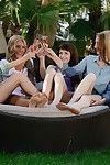 One oiled teens in lesbian orgy