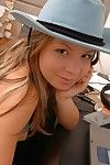 Pretty brunette teen chick wearing hat